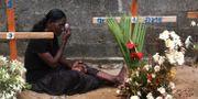 En sörjande kvinna i Sri Lanka efter attackerna. Manish Swarup / TT NYHETSBYRÅN/ NTB Scanpix