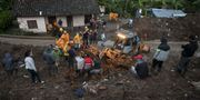 Sökinsatser på platsen. LUIS ROBAYO / AFP