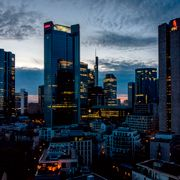 In this Monday, March 29, 2021 file photo, lights burn in some offices of the buildings of the banking district in Frankfurt, Germany. Michael Probst / TT NYHETSBYRÅN