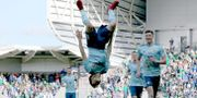 Paul Smyth firar sitt mål med en volt. PAUL FAITH / AFP