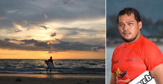 Dery Setyawan med sin surfbräda på Lhoknga-stranden i Banda Aceh. CHAIDEER MAHYUDDIN / AFP