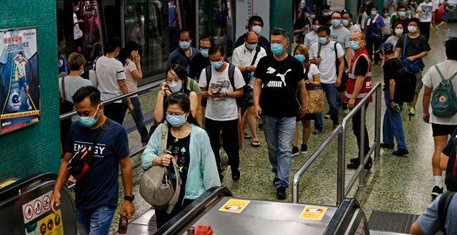 Människor i Hongkong. Illustrationsbild. Kin Cheung / TT NYHETSBYRÅN