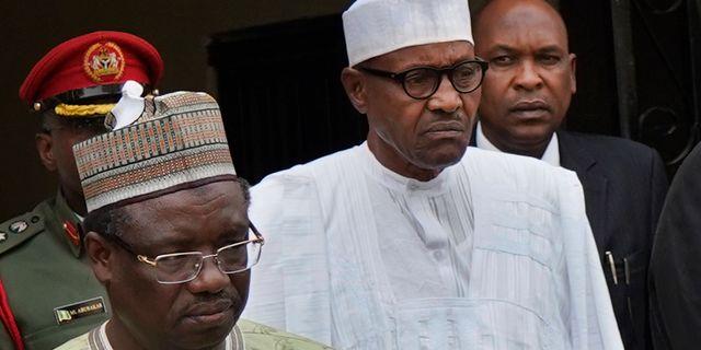 Muhammadu Buhari i mitten. Jerome Delay / TT NYHETSBYRÅN