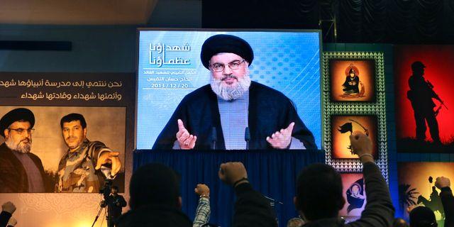 Arkivbild från 2013. Hassan Nasrallah syns under ett tv-sänt tal.  Bilal Hussein / TT NYHETSBYR N