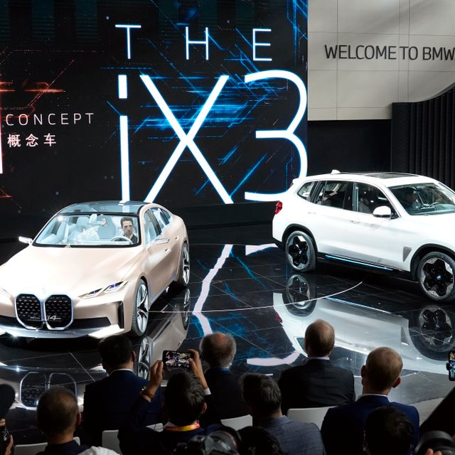 BMW displays its i4 concept car and iX3 electric SUV during the Auto China 2020 show in Beijing on Saturday, Sept. 26, 2020. Ng Han Guan / TT NYHETSBYRÅN