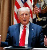 """USA:s president Donald Trumps advokater har tillbakavisat anklagelser om att Trump """"blåst upp"""" sitt nettovärde. Alex Brandon / TT NYHETSBYRÅN"""