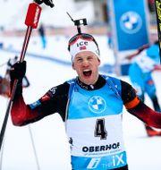 Tarjei Bø vrålar ut sin glädje. Matthias Schrader / TT NYHETSBYRÅN