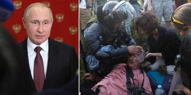 Putin/En polis hjälper en man som skadats i sammandrabbningar mellan demonstranter och polis. TT