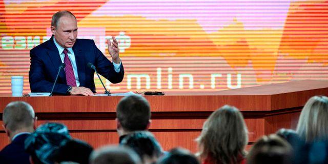 Putin vid pressträffen. ALEXANDER NEMENOV / AFP