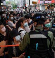 Gripna i samband med demonstrationerna Kin Cheung / TT NYHETSBYRÅN