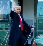 Donald Trump när han klev på helikoptern. Alex Brandon / TT NYHETSBYRÅN