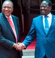 Uhuru Kenyatta och Raila Odinga. SIMON MAINA / AFP