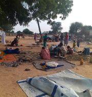 Boende i västra Darfur vid en tidigare attack i somras.  Mustafa Younes / TT NYHETSBYRÅN