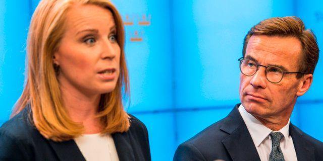 Annie Lööf och Ulf Kristersson. JONATHAN NACKSTRAND / AFP