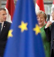 Frankrikes president Emmanuel Macron, Tysklands förbundskansler Angela Merkel och Tysklands premiärminister Paolo Gentiloni. Olivier Matthys / TT / NTB Scanpix