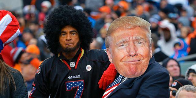 Två football-fans som klätt ut sig till spelaren Colin Kaepernick och meningsmotståndaren president Donald Trump. Aaron Doster / TT NYHETSBYRÅN