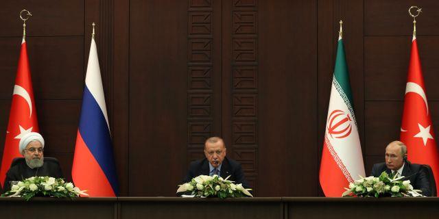 Hassan Rouhani, Recep Tayyip Erdogan och Vladimir Putin. ADEM ALTAN / AFP
