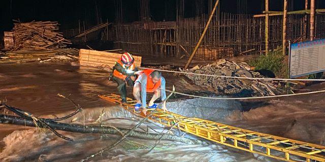 Översvämmad byggarbetsplats i Jiangxi, Kina.  TT NYHETSBYRÅN