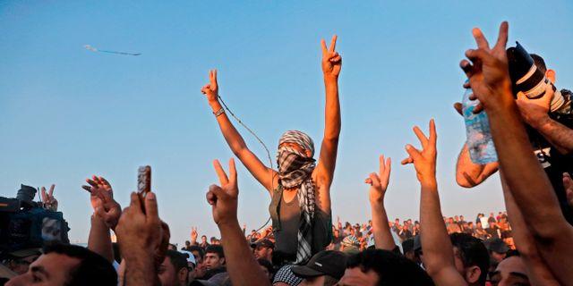 Åhörare vid ett tal av Hamasledaren Ismael Haniyeh på torsdagen THOMAS COEX / AFP