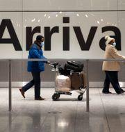 Resenärer på Heathrow i januari. Matt Dunham / TT NYHETSBYRÅN