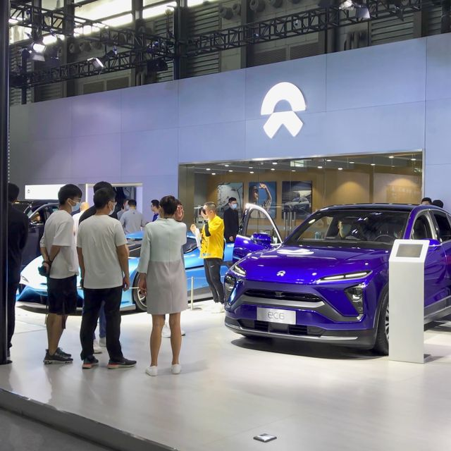Shanghai, China - Sep 30, 2020: NIO booth showroom in Shanghai Pudong International Auto Show. Car exhibition and vehicle promotion. Auto business and economy staff with mask coronavirus period Shutterstock