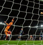 Pierre-Emerick Aubameyang gör Arsenals fjärde mål. GLYN KIRK / AFP