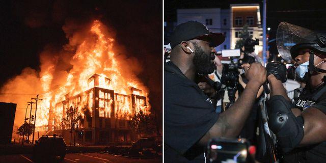 Ett husbygge som satts i brand i Minneapolis/En demonstrant och en polis hälsar på varandra TT