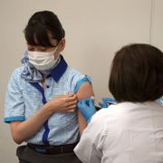 Chinami Kido, an All Nippon Airlines flight attendant, takes Moderna's COVID-19 vaccine shot in Haneda Airport in Tokyo as the airline company began its workplace vaccination, Sunday, June 13, 2021. Kantaro Komiya / TT NYHETSBYRÅN