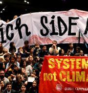 Protest inne på klimatmötet i Katowice. KACPER PEMPEL / TT NYHETSBYRÅN