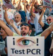 Protester mot de spanska restriktionerna i Madrid den 16 augusti. Andrea Comas / TT NYHETSBYRÅN