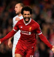 Mohamed Salah jublar efter sitt mål. PAUL ELLIS / AFP