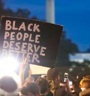 Demonstration utanför Vita huset i Washington DC. Alex Brandon / TT NYHETSBYRÅN