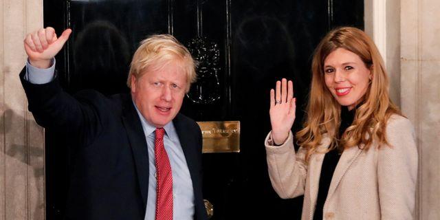 Boris Johnson och Carrie Symonds.  Thomas Mukoya / TT NYHETSBYRÅN