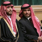 In this Nov. 28, 2006 file photo, Prince Hamzah Bin Al-Hussein, right, and Prince Hashem Bin Al-Hussein, left, brothers King Abdullah II of Jordan, attend the opening of the parliament in Amman, Jordan. Prince Hamzah, the half-brother of Jordan's King Abdullah II, said he has been placed under house arrest in a videotaped statement late Saturday, April 3, 2021. MOHAMMAD ABU GHOSH / TT NYHETSBYRÅN