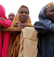 Väljare i Nigeria. AFOLABI SOTUNDE / TT NYHETSBYRÅN