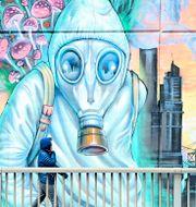 Muralmålning i Toronto. Nathan Denette / TT NYHETSBYRÅN