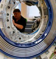 Arkivbild: Tekniker arbetar på en av Siemens CAT-scanmaskiner, ma 2017.  Michaela Rehle / TT NYHETSBYRÅN