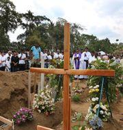 En präst håller i en begravning  Manish Swarup / TT NYHETSBYRÅN/ NTB Scanpix