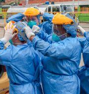 Sjukvårdspersonal i Colombia. JOAQUIN SARMIENTO / TT NYHETSBYRÅN