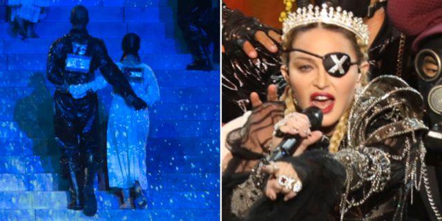 De två dansarna med flaggor på ryggen/Madonna.  TT