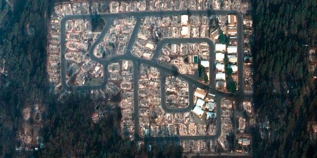 Satellitbilder visar förödelsen i ett kvarter i staden Paradise. TT NYHETSBYRÅN/ NTB Scanpix