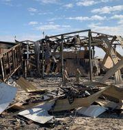 Al-Asad-basen fick stora skador efter attacken. AYMAN HENNA / AFP