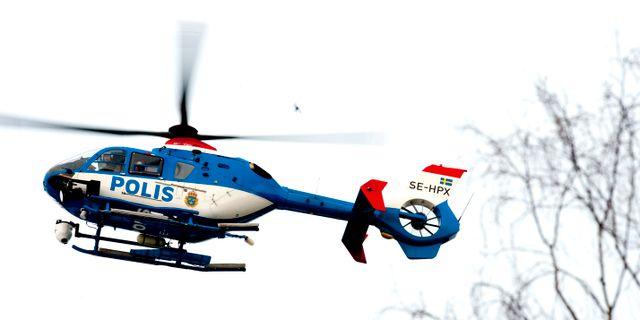 En polishelikopter, arkivbild. PONTUS LUNDAHL / TT / TT NYHETSBYRÅN