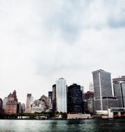 Jeffrey Epstein/Wall Street i New York fotograferat från vattnet. TT