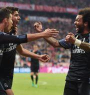 Christiano Ronaldo firar med Marco Asensio och Marcelo. CHRISTOF STACHE / AFP