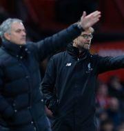 Tottenhamtränaren José Mourinho till vänster och Liverpooltränaren Jürgen Klopp till höger. PHIL NOBLE / BILDBYRÅN
