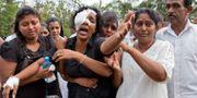 Kvinna sörjer i Negombo. Gemunu Amarasinghe / TT NYHETSBYRÅN