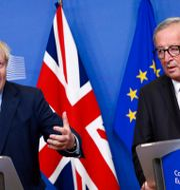 Boris Johnson och Jean-Claude Juncker. FRANCOIS LENOIR / TT NYHETSBYRÅN