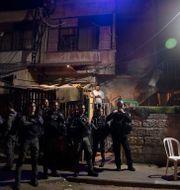 Israelisk polis vaktar ett hus bebott av israeliska bosättare i Sheikh Jarrah Maya Alleruzzo / TT NYHETSBYRÅN