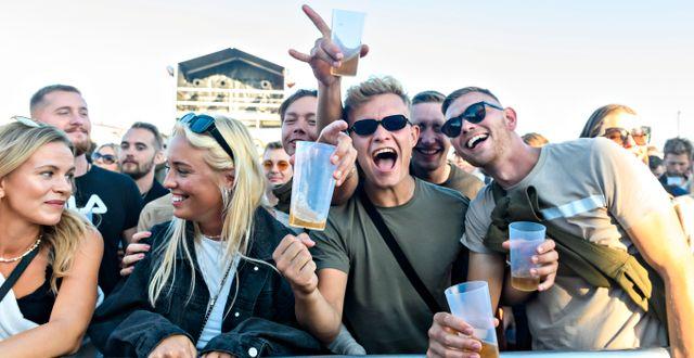 """Besökare i samband med D-A-D:s spelning på """"Tilbage til live"""". Torben Christensen / TT NYHETSBYRÅN"""
